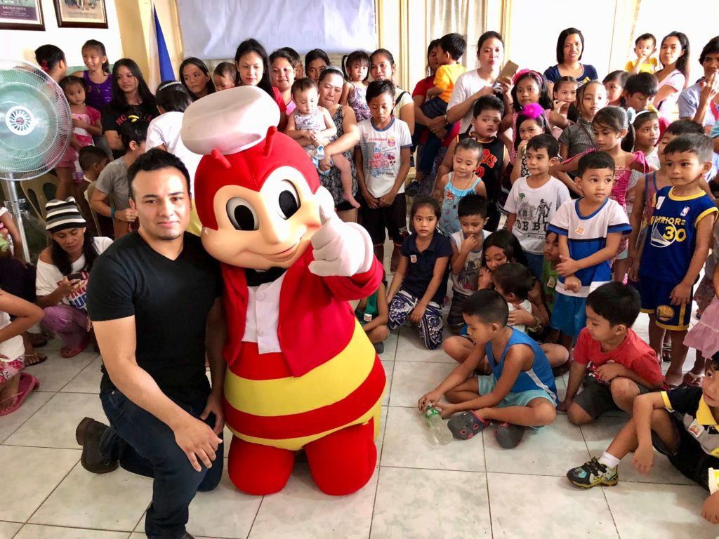 Kids Outreach in Dasmariñas 2017 with Jollibee mascot and John Fernandez (1)